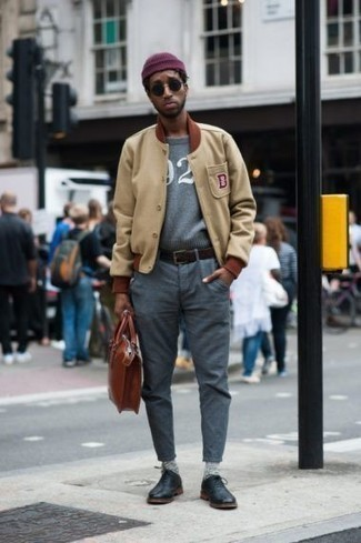 Purple Beanie Outfits For Men: This bold casual combo of a tan varsity jacket and a purple beanie takes on different forms according to the way you style it out. Get a bit experimental in the footwear department and complement your ensemble with black leather oxford shoes.