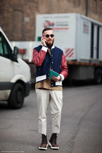 How to Wear a Blue Varsity Jacket For Men: Choose a blue varsity jacket and white chinos for both on-trend and easy-to-wear look. Finishing off with a pair of dark brown leather casual boots is a fail-safe way to add a little flair to your look.