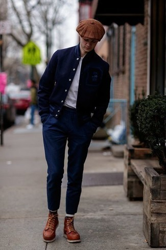 Men's Looks & Outfits: What To Wear In Spring: If you wish take your casual style up a notch, consider pairing a navy varsity jacket with navy chinos. Complete your look with tobacco leather casual boots for a dose of refinement. So if you're scouting for an awesome transition getup, this one is great.