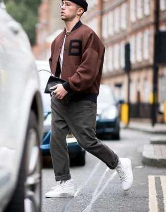 Charcoal Chinos Outfits: Try teaming a brown varsity jacket with charcoal chinos and you'll look like the raddest dude around. Ramp up your look by wearing white canvas high top sneakers.