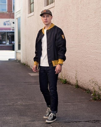 Varsity Jacket Outfits For Men: Putting together a varsity jacket with navy jeans is an on-point pick for an off-duty outfit. And if you wish to effortlessly play down this outfit with footwear, why not add navy and white canvas high top sneakers to the mix?