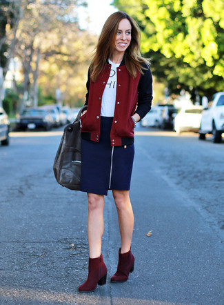How to wear: burgundy varsity jacket, white and black print crew-neck t-shirt, navy pencil skirt, burgundy suede ankle boots