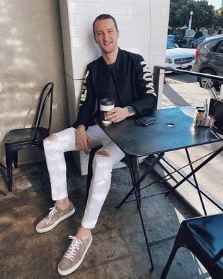 Black Print Varsity Jacket Outfits For Men: This casual and cool look is so simple: a black print varsity jacket and white ripped skinny jeans. Let your styling savvy really shine by completing your outfit with a pair of tan suede low top sneakers.