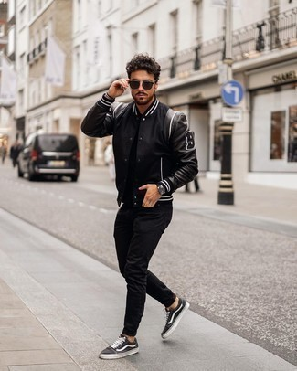 Black Sunglasses Outfits For Men: A black varsity jacket and black sunglasses are a street style pairing that every fashion-savvy man should have in his casual collection. You could perhaps get a bit experimental in the footwear department and lift up this look by rocking black and white canvas low top sneakers.
