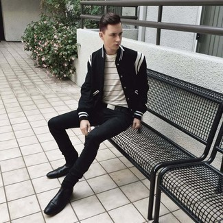 Black Skinny Jeans Outfits For Men: Make a black and white varsity jacket and black skinny jeans your outfit choice for a laid-back twist on off-duty ensembles. A pair of black leather chelsea boots effortlessly bumps up the wow factor of your look.