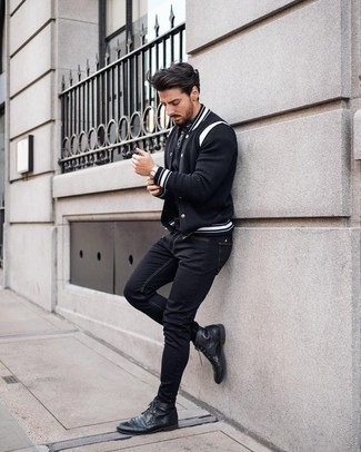 Brogue Boots Outfits: Consider pairing a black varsity jacket with black skinny jeans to pull together an edgy and absolutely dapper look. Brogue boots are guaranteed to bring a dose of polish to your outfit.