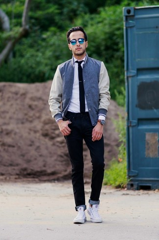 A Club Monaco men's Varsity Jacket and black skinny jeans will convey a carefree easy vibe. Tap into some David Gandy dapperness and complete your ensemble with white low top sneakers. This combo is everything for those warmer days of spring.