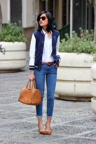 How to wear: navy and white varsity jacket, white dress shirt, blue skinny jeans, brown suede pumps
