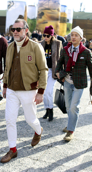 How to wear: beige varsity jacket, brown gilet, white knit turtleneck, white chinos