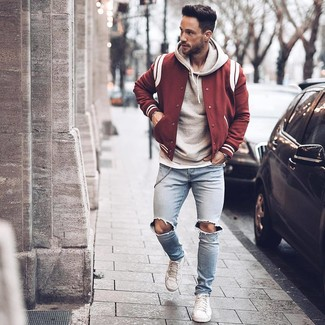 How to wear: burgundy varsity jacket, grey hoodie, white crew-neck t-shirt, light blue ripped skinny jeans