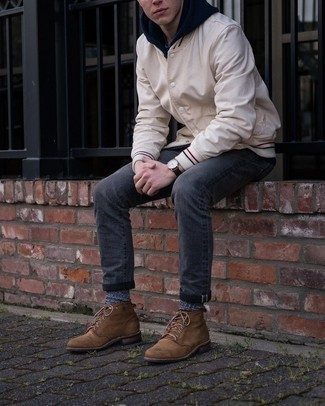 Charcoal Jeans Outfits For Men In Their 20s: A beige varsity jacket and charcoal jeans worn together are a perfect match. Go off the beaten track and change up your ensemble with a pair of brown leather casual boots. This ensemble looks great on 20-year-old gentlemen.