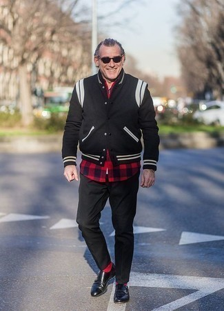 How to Wear Red Socks For Men: If you're a fan of relaxed dressing when it comes to fashion, you'll appreciate this contemporary combination of a black varsity jacket and red socks. With shoes, go for something on the more elegant end of the spectrum and complete this outfit with a pair of black leather double monks.