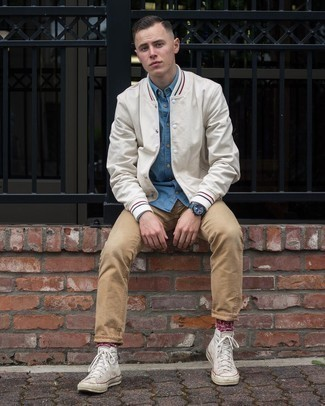 Varsity Jacket Outfits For Men: A varsity jacket and khaki chinos are essential menswear items, without which our wardrobes would surely be incomplete. Want to break out of the mold? Then why not complete this outfit with white canvas high top sneakers?