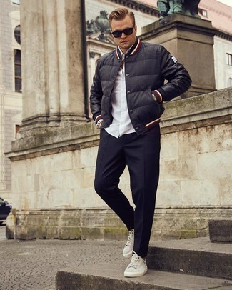 Varsity Jacket Outfits For Men: A varsity jacket and black chinos worn together are a perfect match. For maximum style, complete your look with a pair of grey suede low top sneakers.