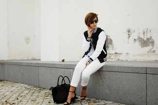 If it's comfort and ease that you're searching for in an outfit, make a black and white varsity jacket and white capri pants your outfit choice. Grab a pair of black leather heeled sandals to instantly up the chic factor of any outfit. This combination is a great option come spring.