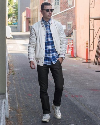 Varsity Jacket Outfits For Men: Wear a varsity jacket and charcoal chinos for a fuss-free ensemble that's also well-executed. Clueless about how to round off? Introduce white canvas high top sneakers to this ensemble for a more casual twist.