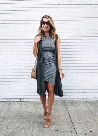 How to Wear a Tan Leather Crossbody Bag: This combo of a charcoal vest and a tan leather crossbody bag is hard proof that a safe casual look can still be really interesting. Bring a fresh twist to your look by slipping into brown leather wedge sandals.