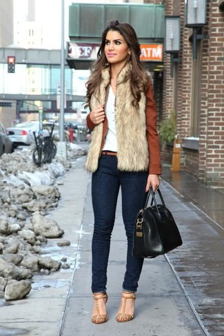 How to wear: beige fur vest, brown leather bomber jacket, white henley shirt, navy skinny jeans