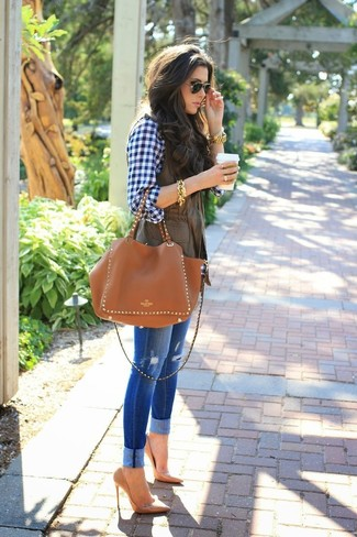 A dark brown vest and blue distressed skinny jeans will give off this very sexy and chic vibe. A cool pair of camel leather pumps is an easy way to upgrade your look.