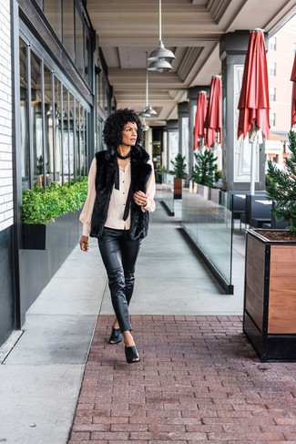 How to wear: black fur vest, beige button down blouse, black leather skinny pants, black leather mules
