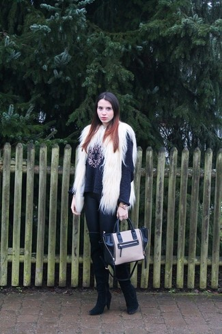 How to wear: white fur vest, charcoal embellished crew-neck sweater, black leather leggings, black suede over the knee boots