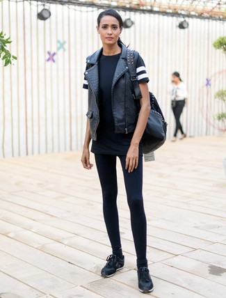 Try pairing a black leather vest with black leggings for a lazy Sunday brunch. Make black running sneakers your footwear choice for a more relaxed aesthetic.
