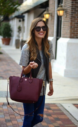 How to wear: black leather vest, grey crew-neck t-shirt, navy ripped skinny jeans, burgundy leather tote bag