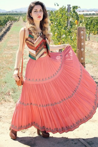 A multi colored patchwork vest and a dusty pink pleated maxi skirt will convey a carefree, cool-girl vibe. For footwear go down the classic route with brown leather booties.