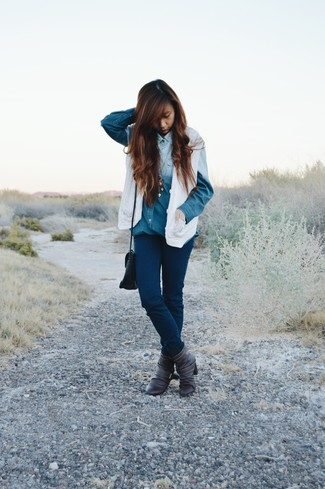 This pairing of a denim shirt and navy slim jeans is very easy to throw together and so comfortable to sport as well! Throw in a pair of dark grey leather booties to kick things up to the next level. We love this one, especially for springtime.