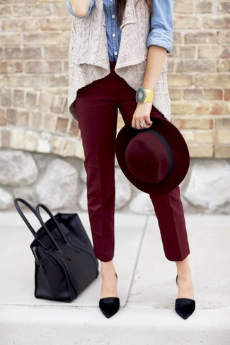 Pairing a grey knit vest with dark red skinny pants is a comfortable option for running errands in the city. Black suede pumps will add elegance to an otherwise simple look.
