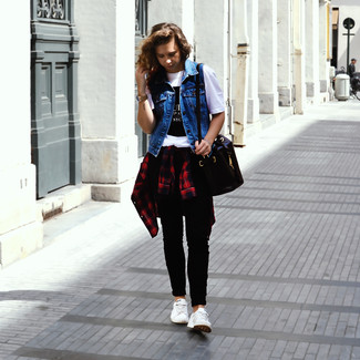 Dress in a blue denim vest and black skinny jeans for a Sunday lunch with friends. A pair of white low top sneakers will seamlessly integrate within a variety of outfits.