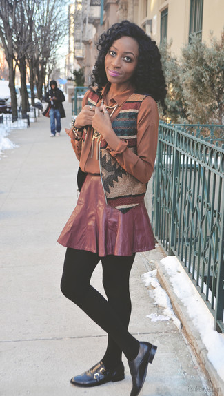 Burgundy Pleated Mini Skirt Outfits: This is solid proof that a multi colored geometric vest and a burgundy pleated mini skirt look awesome when worn together in a relaxed casual look. Infuse this getup with a hint of polish by rounding off with black leather double monks.