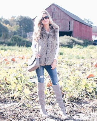How to wear: grey fur vest, white long sleeve t-shirt, blue ripped skinny jeans, grey suede over the knee boots