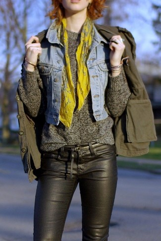 How to wear: light blue denim vest, olive military jacket, charcoal crew-neck sweater, black leather skinny jeans