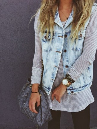 How to wear: light blue denim vest, grey oversized sweater, black leggings, grey quilted leather bucket bag