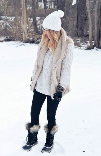 How to wear: beige fur vest, white knit oversized sweater, black skinny jeans, black snow boots