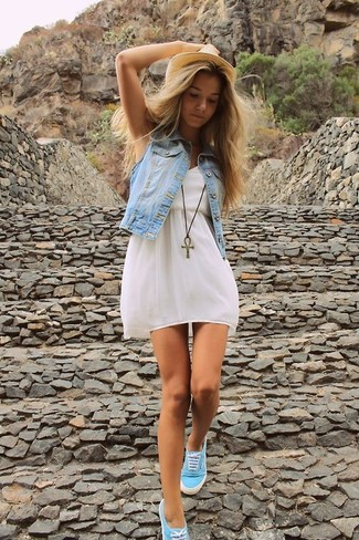 How to wear: light blue denim vest, white skater dress, aquamarine low top sneakers, khaki straw hat
