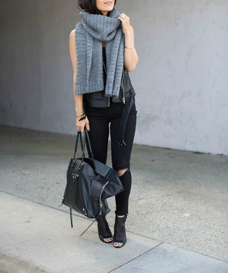 Wear a black leather vest with a grey knit scarf for a casual get-up. Bump up the cool of your look by completing it with black cutout leather ankle boots. This one is a great idea if you're planning a stylish summer-to-fall transition outfit.