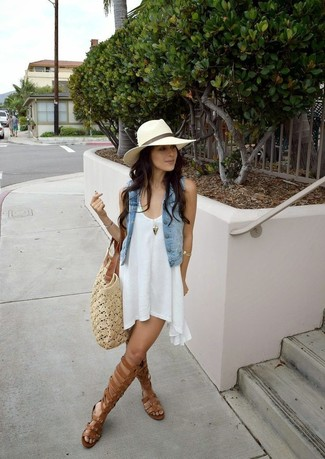 How to wear: light blue denim vest, white swing dress, brown leather knee high gladiator sandals, beige crochet tote bag