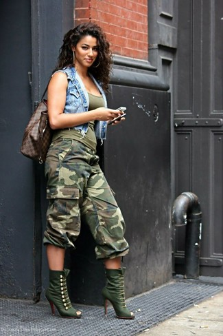 Try pairing a blue denim vest with olive camouflage cargo pants if you're hunting for an outfit idea for when you want to look casually cool. A pair of olive boots will be a welcome addition to your ensemble. This getup is a pretty nice choice, especially for autumn, when the temperatures are dropping.