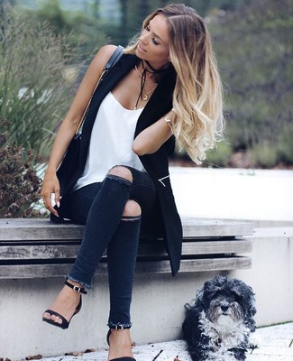 How to wear: black vest, white silk tank, charcoal ripped skinny jeans, black leather heeled sandals