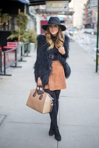 How to wear: black fur vest, black turtleneck, tan suede button skirt, black suede over the knee boots