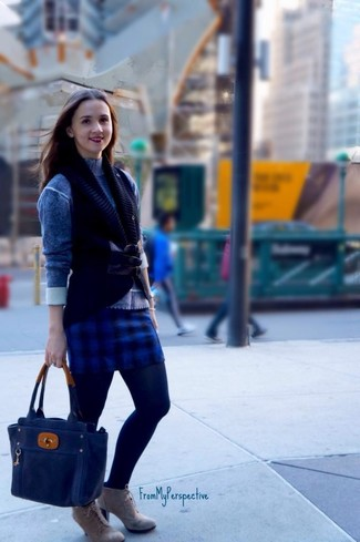 Consider wearing a black knit vest and a blue check mini skirt for a casual coffee run. Up the ante of your ensemble with grey suede ankle boots. A killer ensemble that transitions easily into fall like this one makes it so easy to welcome the new season.