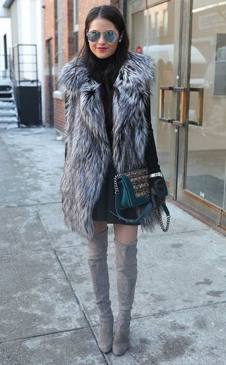 The versatility of a grey fur vest and a black pleated skirt makes them investment-worthy pieces. Grey suede over the knee boots will bring a classic aesthetic to the ensemble.