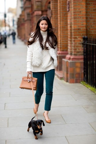 How to wear: white fur vest, white knit turtleneck, teal skinny pants, tobacco leather pumps