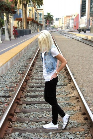 How to wear: light blue denim vest, white v-neck t-shirt, black skinny jeans, white low top sneakers