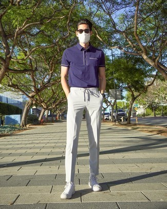 Violet Polo Outfits For Men: This laid-back pairing of a violet polo and grey chinos is very easy to pull together in next to no time, helping you look awesome and ready for anything without spending too much time digging through your wardrobe. White canvas high top sneakers will give a dose of stylish nonchalance to an otherwise standard look.