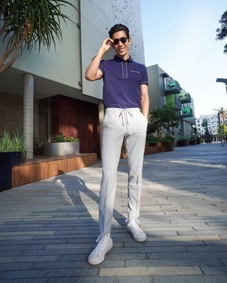 Violet Polo Outfits For Men: This laid-back combo of a violet polo and grey chinos is very easy to put together in no time, helping you look seriously stylish and prepared for anything without spending a ton of time rummaging through your wardrobe. Infuse some stylish effortlessness into your look with white canvas high top sneakers.