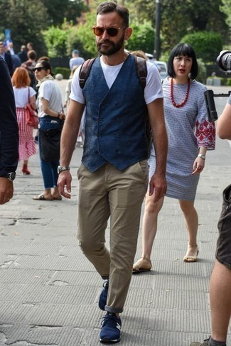 How to Wear a Navy Waistcoat: Channel your inner British gentleman and make a navy waistcoat and khaki chinos your outfit choice. Go the extra mile and break up your outfit by slipping into navy athletic shoes.
