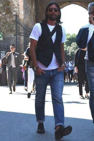 How to Wear Blue Ripped Jeans For Men: Consider pairing a black waistcoat with blue ripped jeans for a sleek refined look. Finishing with a pair of black suede derby shoes is a fail-safe way to bring some extra depth to this getup.